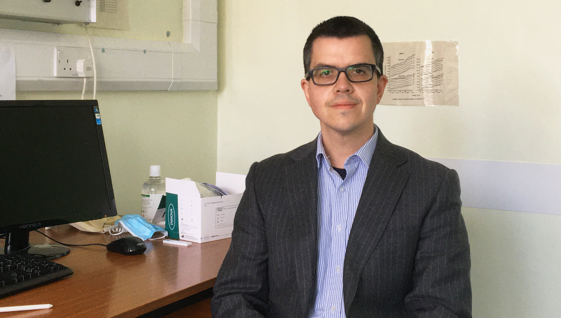 Dr. Alisdair Mcneill poses for a photo in his pediatric office at Sheffield Children's Hospital.